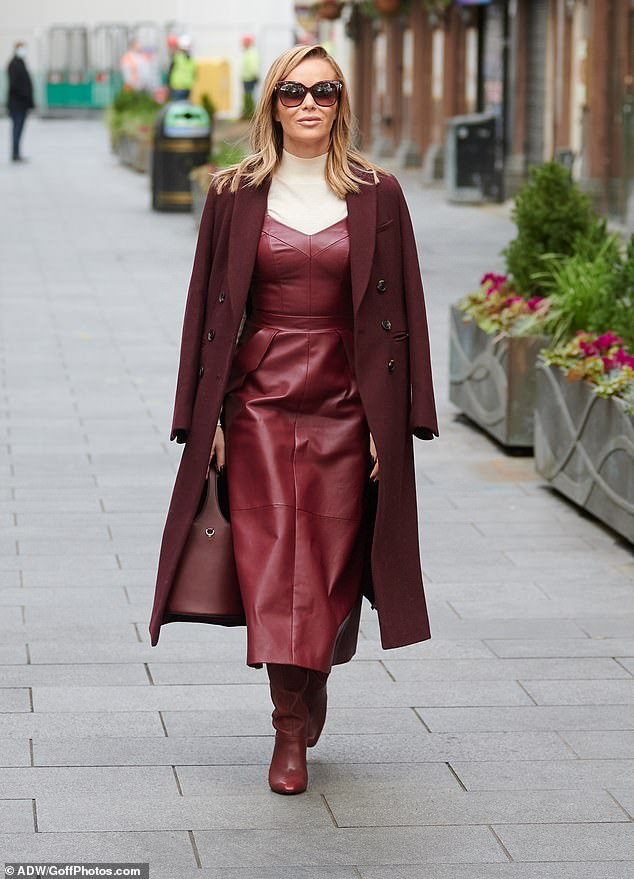 Wow: The former Wild At Heart actress only elevated her look with her choice of outerwear, which featured square-framed shades and a maroon coat draped across her shoulders