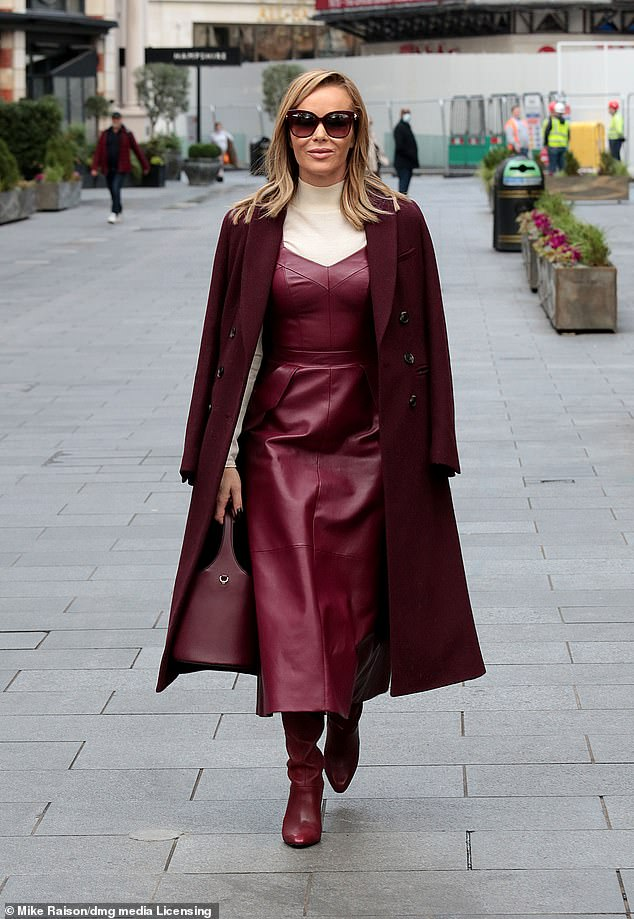 Working it:The presenter, 49, brought signature glamour to the streets of central London as she slipped into a burgundy leather dress by Leloine, teamed with a pair of Reiss boots