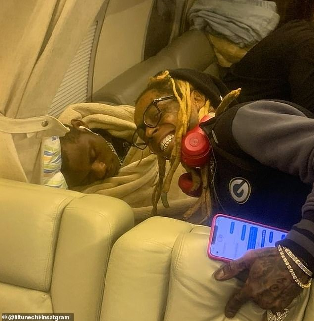 The private jet was searched by agents when it landed in Florida from California on December 23. Wayne is pictured above on a private jet in January