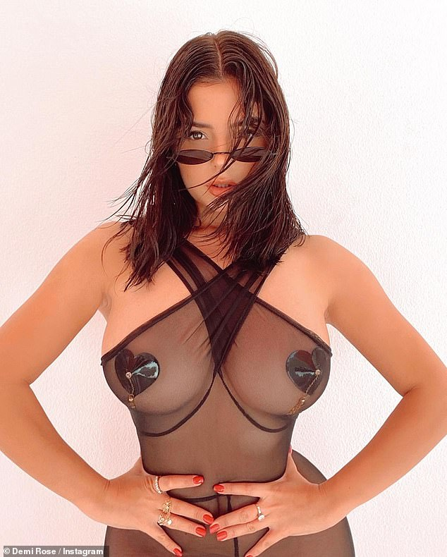 Eye-popping:The glamour model, 25, slipped into a sheer black dress and used nothing but heart-shaped nipple pasties to cover her very ample assets