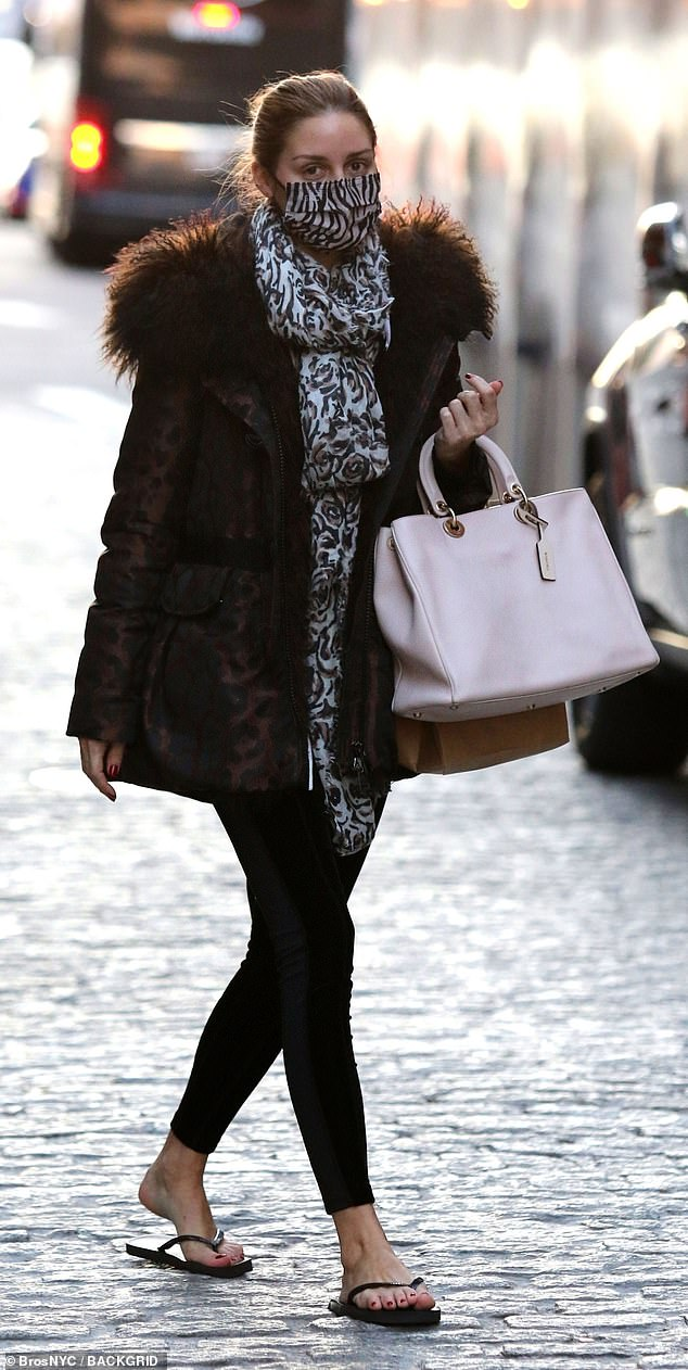 Barefoot in the cold:Olivia Palermo was seen venturing out on Tuesday in New York City, on her way from of a pedicure appointment with her bare feet in flimsy black flip-flops