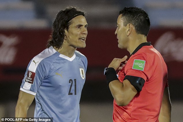 Edinson Cavani complains to the referee after being sent off during Uruguay's 2-0 loss to Brazil