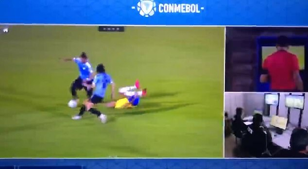 Richarlison rolls around on the floor after Cavani's mistimed tackle during World Cup qualifier