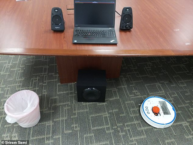 Researchers repurposed the laser-based navigation system on a vacuum robot (right) to pick up sound vibrations and capture human speech bouncing off objects like a rubbish bin placed near a computer speaker on the floor