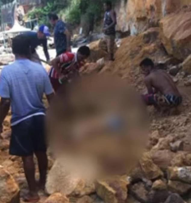 People try to save the family after being crushed by rocks on the beach in the upstate of Rio Grande do Norte on Tuesday