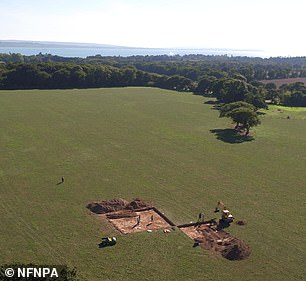 The research into the ring barrow was launched after such showed up as a crop mark in an aerial image of the dig site (pictured) taken in 2013 during a search for the remains of a World War II gun emplacement and a Roman Temple on the Beaulieu Estate. Subsequent geophysical surveys revealed that there were interior disturbances within the ring ditch — suggesting either the presence of either primary funerary activity, or later disruption by modern antiquarians