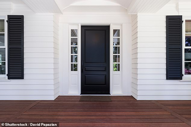 As one of the UK's leading colour therapists, Alison Standish, in collaboration with LG, told FEMAIL which colours to use in order to sell your house and making it as welcoming as possible. She said a black front door conveyed a sleek look, and that dark colours gave a feeling of authority and structure to a house (stock image)