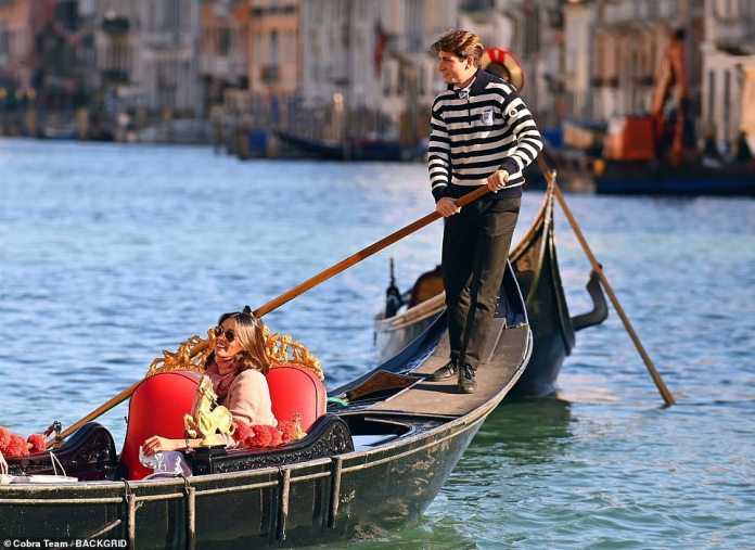 What a view!  Mel seemed to make the most of the Venetian sights as she was escorted along the canal by the gondolier, while she was also joined by a male companion inside the boat.