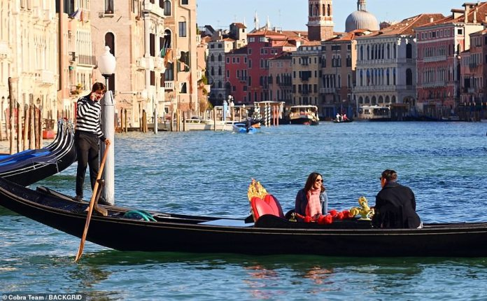Stunning view: the gondolier seemed slightly preoccupied with a phone call