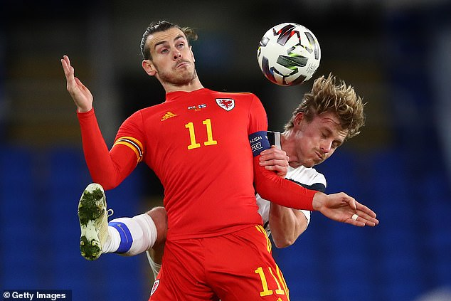 Wales and Tottenham winger Gareth Bale battles for the ball with Finland's Rasmus Schuller
