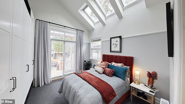 Chic: One guest bedroom was completed with stunning sky lights and oversized white cupboards
