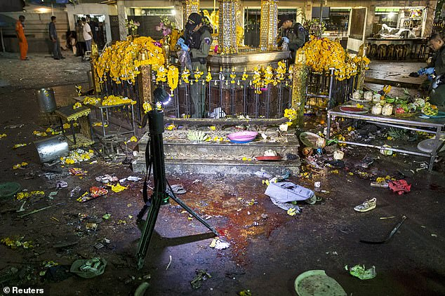 Sad: Jimmy, Jane and their grandchildren were staying at a hotel across the road from the iconic Erawan Shrine - the site where one of Thailand's most notorious terror attacks unfolded. Pictured: Blood and personal belongings of victims after the explosion on August 17, 2015