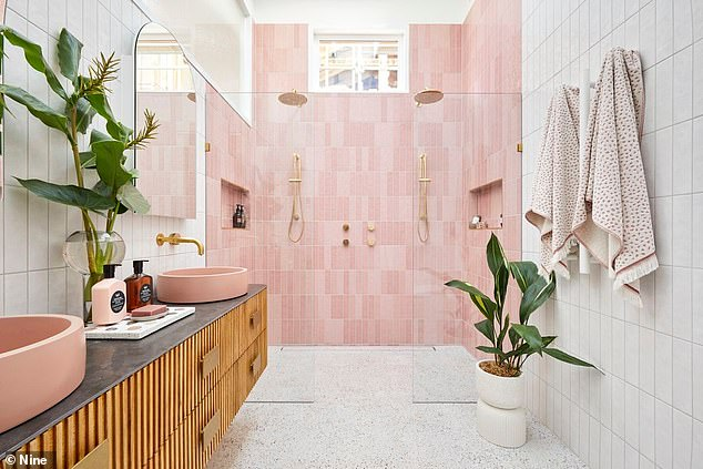 Picture perfect: The master en suite is every pink lover's dream and features a double shower with gold hard ware and pink tiles, as well as an abundance of leafy green plants