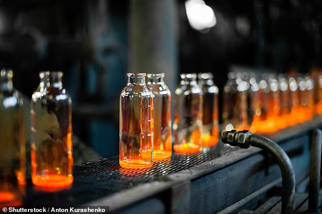 The manufacturing process for glass bottles (pictured) is so energy-intensive that it makes them much worse for environment than plastic bottles, a study has warned (stock image)