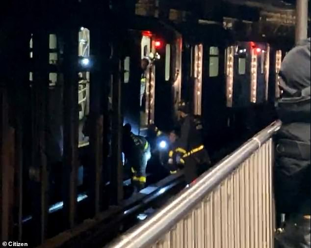 FDNY rescue the 40-year-old woman pushed under a train by a stranger on Thursday