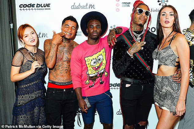 Mikey Polo (second right, at New York Fashion Week) categorically denied Bobby Jr was depressed, saying he had suffered 'ups and downs' but was a 'very happy person'