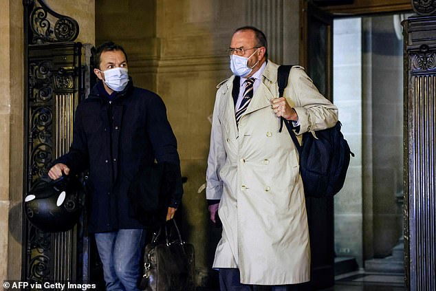Chris Norman pictured leaving the courthouse in Paris yesterday