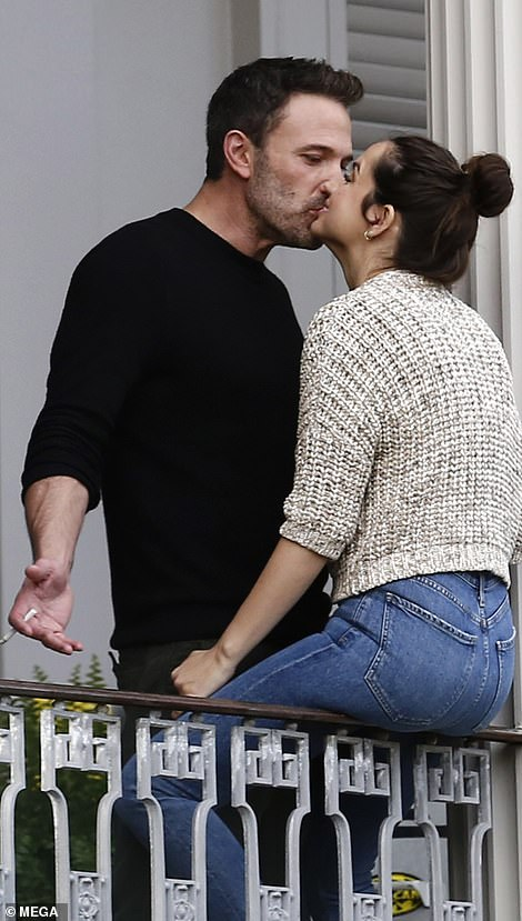 Loved up: The 48-year-old actor couldn't get enough of his girlfriend during a break in filming