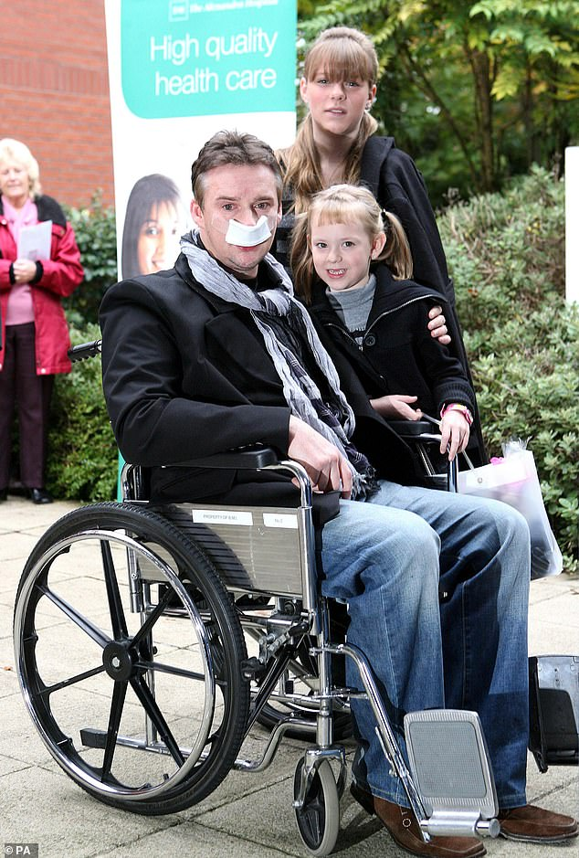 His world: The opera star described how it was the children that gave him the motivation to fight for his life and beat the illness(pictured after his second surgery with children Hannah, then 8, and Rebecca, then 13, in October 2007)