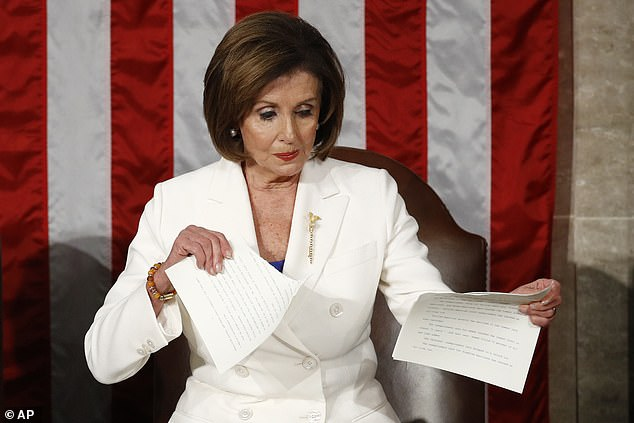 In this Tuesday, Feb. 4, 2020, file photo, House Speaker Nancy Pelosi, of California, tears her copy of President Donald Trump's State of the Union address after he delivered it to a joint session of Congress on Capitol Hill in Washington