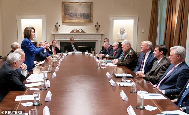 Speaker of the House Nancy Pelosi stands and speaks to U.S. President Donald Trump during an October 16 meeting about Syria between lawmakers, the president and members of the Trump administration in the White House cabinet room in an official White House handout photo released by the White House in Washington, U.S. October 17, 2019. She hasn't been at the White House since