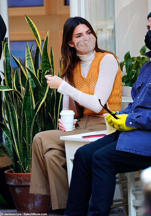 Life of leisure:Jenner, who was joined by a few of her closest pals, leisurely sipped on a hot cup of coffee, while sitting on the patio of a nearby cafe