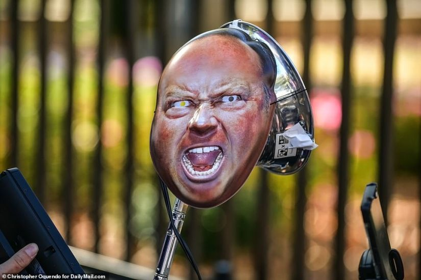 One of the protesters at the 'stop the steal' rally brought an Alex Jones mask to the demonstration in Atlanta on Friday