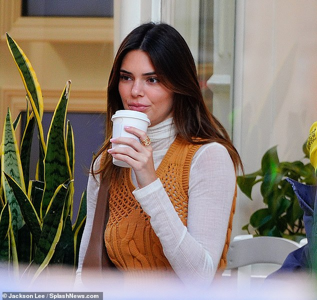 Natural beauty:She appeared to be wearing little to no makeup and her signature brunette hair was parted down the middle and styled into loose waves