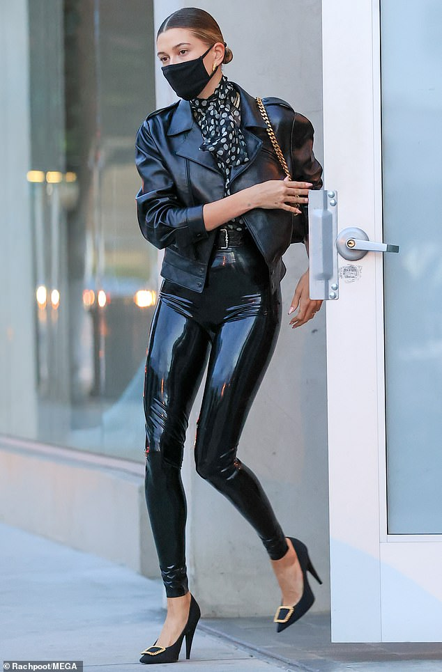 Back in black: Hailey Bieberslipped her killer legs into some skintight black latex YSL look as she left celebrity stylist Maeve Reilly's office in Los Angeles, ahead of her birthday on Sunday, November 22