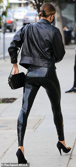 Biker babe: Hailey layered it with a black leather motorcycle jacket, which she wore with the sleeves bunched up below her elbows