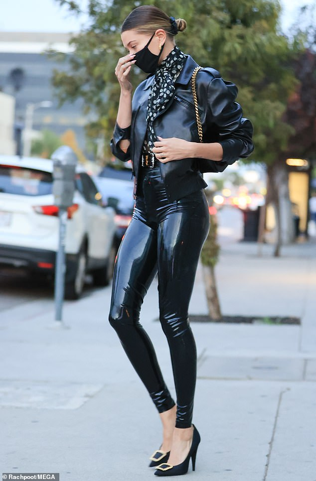 In the bag: The Drop the Mic host carried a black leather handbag on a gold chain strap over her shoulder