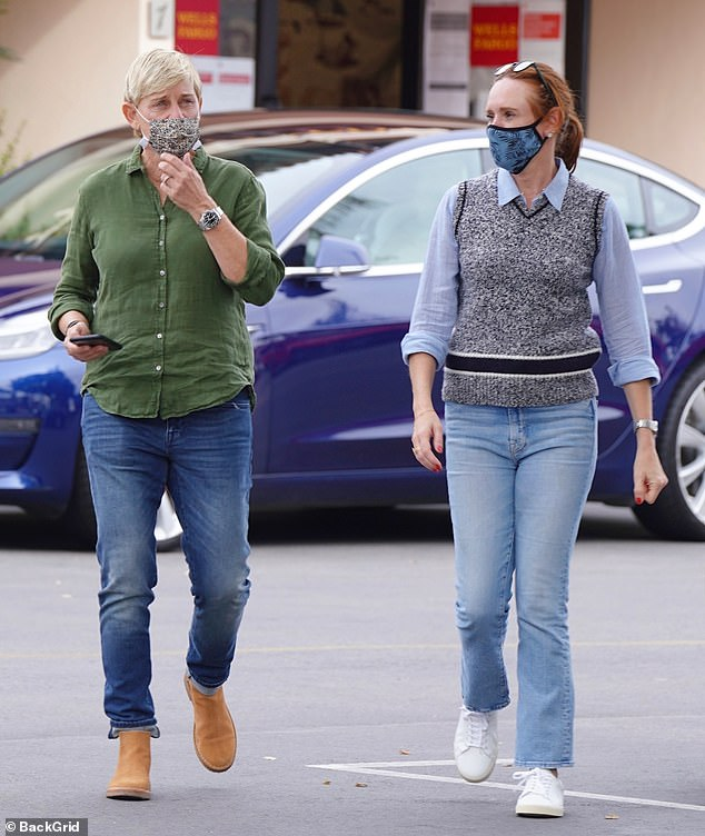 Casual cool: The talk show queen dressed in faded denim blue jeans with an untucked green, button-down shirt and an ankle boots