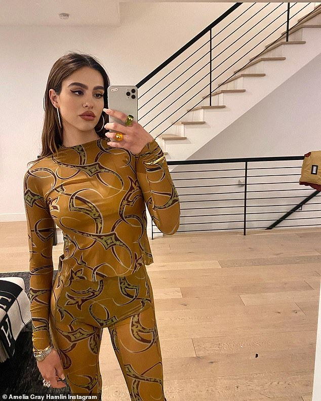 Dolled up:Amelia Hamlin looked ready for a night out on the town in a series of sultry self-portraits uploaded to Instagram on Friday