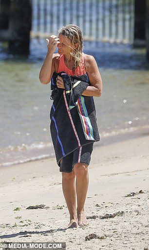 Stunner:The mum-of-three wore minimal make-up for the occasion, showing off her natural and age-defying visage as she enjoyed a leisurely afternoon in the sun