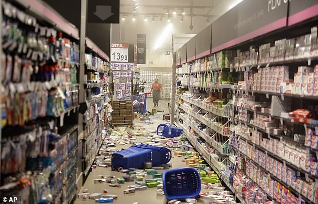 Products knocked off shelves by protesters litter an aisle at a Carrefour supermarket during a protest against the murder of Black man Joao Alberto Silveira Freitas