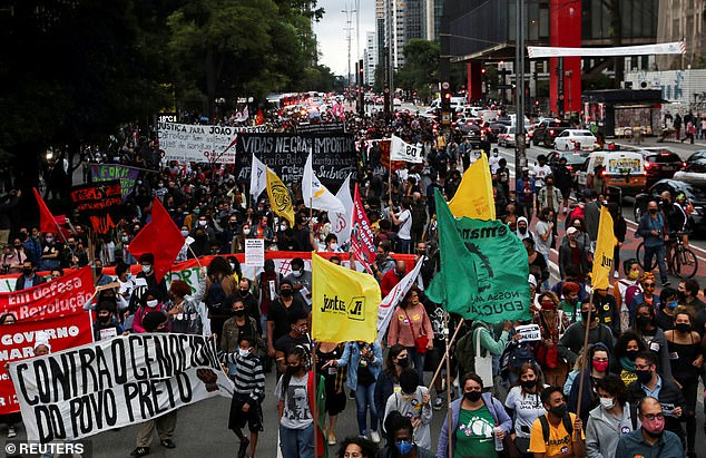 Demonstrators march in Sao Paulo during the National Black Consciousness Day and in protest against the death of Joao Alberto Silveira Freitas