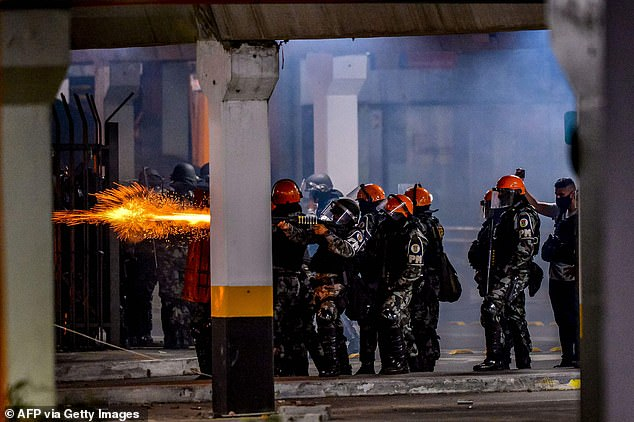 Brazilian military police clash with demonstrators during a protest at the entrance of a Carrefour supermaket where Joao Alberto Silveira Freitas was beaten to death