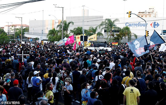 Residents protest against racism, after Joao Alberto Silveira Freitas was beaten to death by security guards at a Carrefour supermarket in Porto Alegre