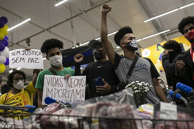 Activists including members of Black Lives Matter demonstrate inside a Carrefour supermarket against the murder of Black man Joao Alberto Silveira Freitas