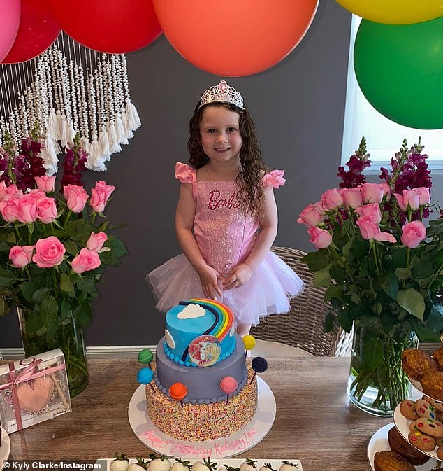 Cute:. Her cake consisted of pastel layers, cake pop embellishments and a unicorn and Barbie theme