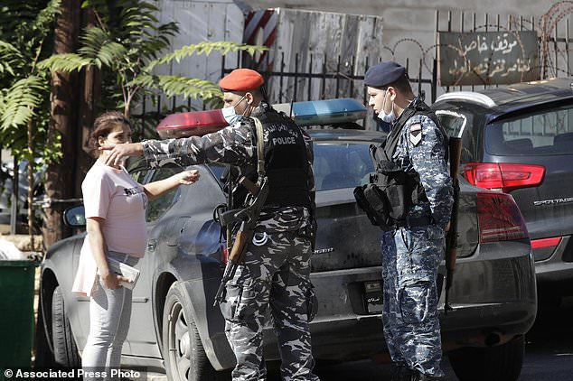 Relatives of prisoners attempted to speak with Lebanese policemen who stood guard outside the prison to see what had happened to their family members