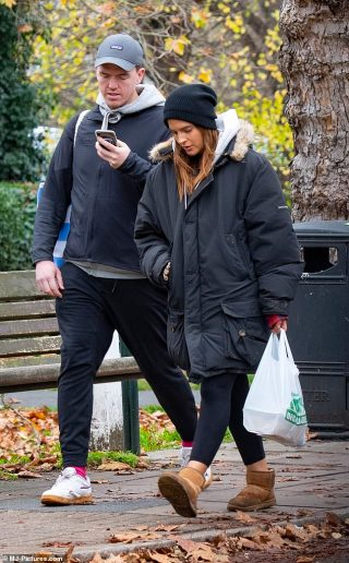 Binky Felstead bundles up in an oversized black coat while out with fiance Max Darnton