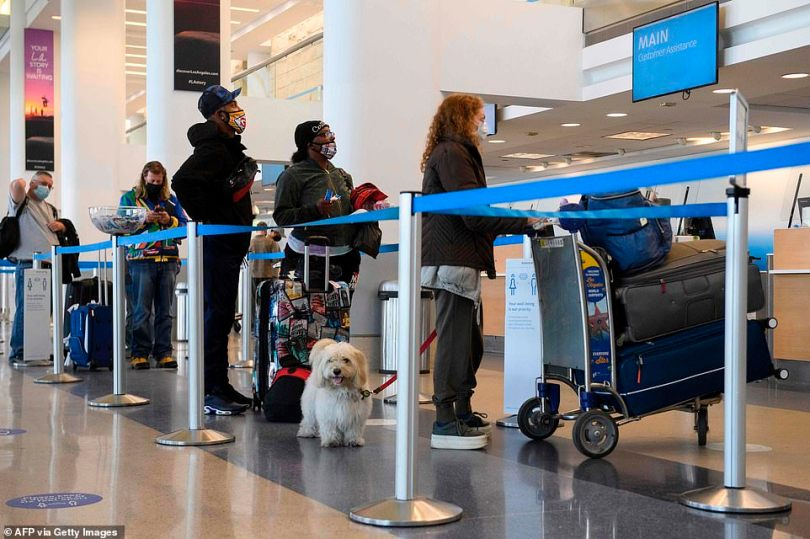 LAX:Travelers wait to check baggage for an American Airlines flight during the Covid-19 pandemic at Los Angeles International Airport (LAX) on November 18