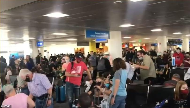 PHOENIX:In Arizona, travelers were seen crowding the gates at Phoenix's Sky Harbor on Friday where one person described the scene 'about as crowded as it was before COVID hit'
