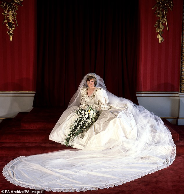 The Princess of Wales seated in her lavish bridal gown at Buckingham Palace after marrying Prince Charles