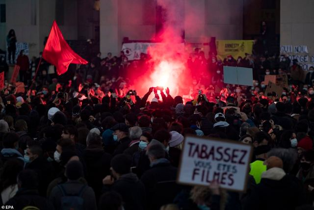 Police today used water cannons as they clashed with thousands of demonstrators who took to the streets in France to protest against a proposed security law which civil liberties campaigners say would impinge on freedom of information and media rights. Pictured: Protesters in Paris today