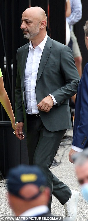 Glamorous:Harry meanwhile wore a traditional grey suit, without a tie