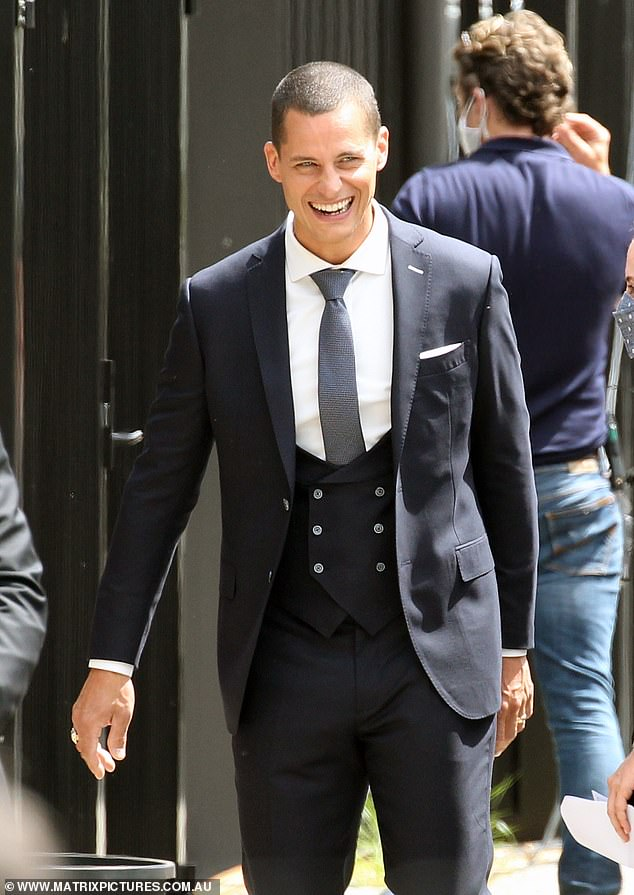 Dashing: Luke (pictured) meanwhile looked dashing as he beamed in his sleek three-piece suit