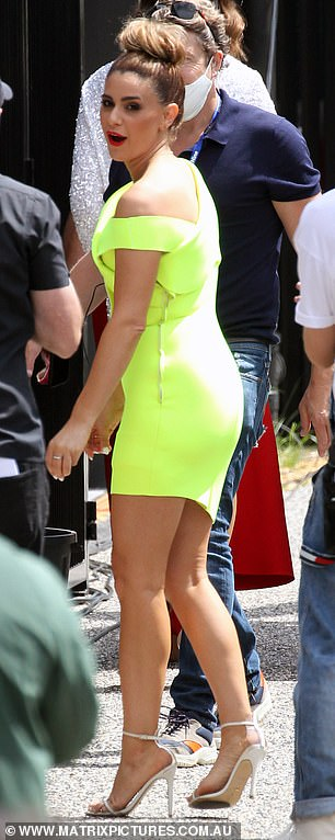Not so mellow in yellow!Tash wore a fluorescent yellow mini-dress and strappy white heels