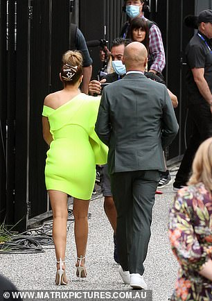 Stylish: Tash wore a fluorescent yellow mini-dress and strappy white heels. Harry meanwhile wore a traditional grey suit, without a tie
